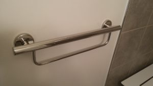 This beautiful grab bar also doubles as a towel bar.