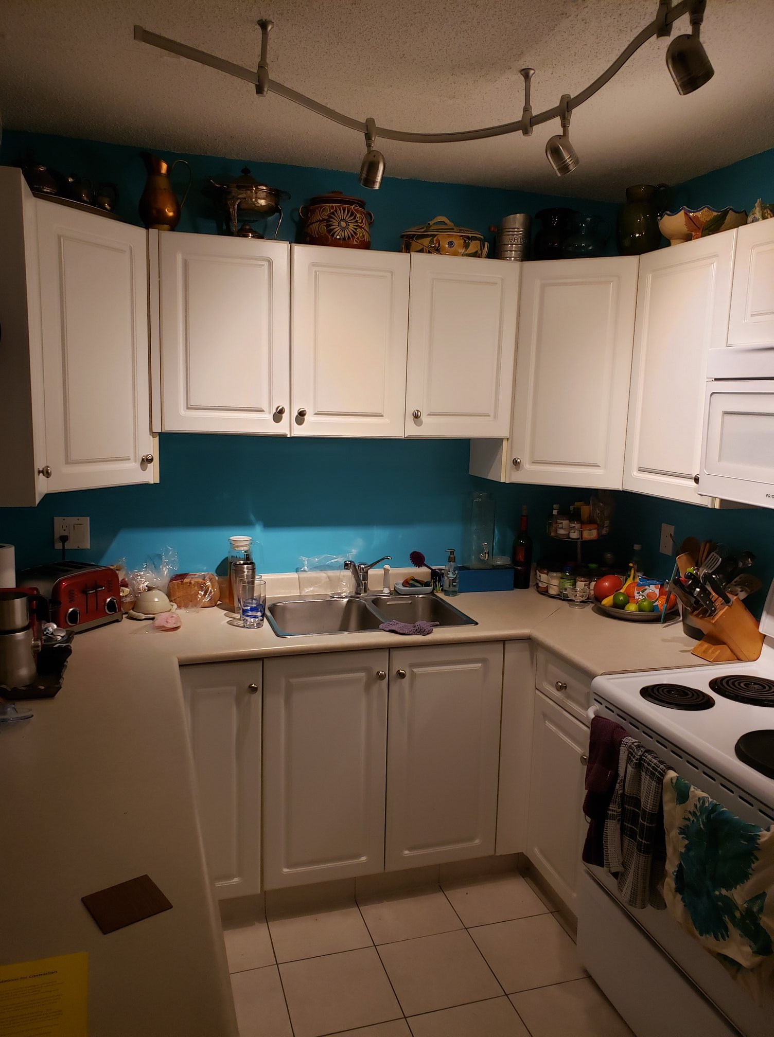 Before and after of modern kitchen renovation with cabinets, countertops and fixtures.